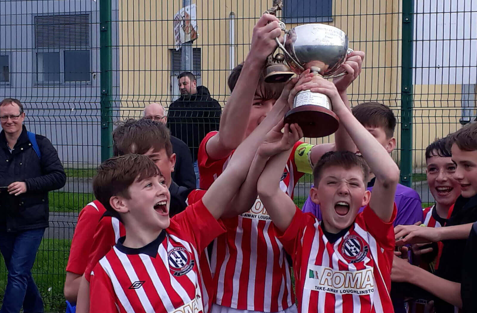 District youth football competition winners lifting the cup